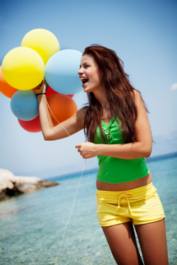 young female ith colorful balloons
