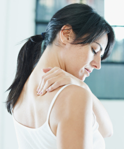 woman massaging neck.