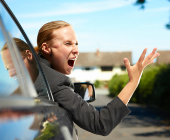 angry businesswoman in car angry with another driver